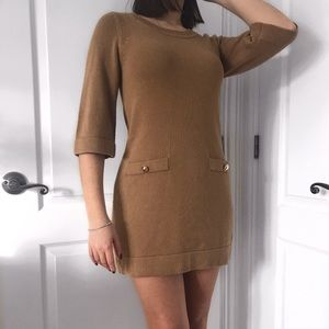 Beige dress with gold buttons on pockets